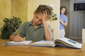 boy homework worry 300x199 When Does Worry Become Obsessive Compulsive Disorder?  Part 1