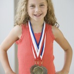 girl medal reward 150x150 Rewards may work like drugs for children with ADHD.