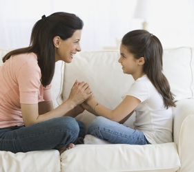 mom girl talking listening1 A Quick Guide To Understanding Your Child