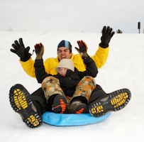 father son tubing snow Outdoor Winter Activities for the Whole Family