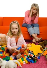 mom girl toys clutter How to Declutter Your Childrens Toys