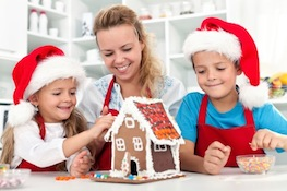 mom kids gingerbread house making How to Stay Organized and Sane This Holiday Season