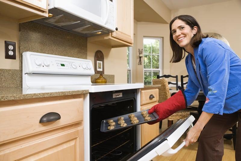 Woman baking cookies.