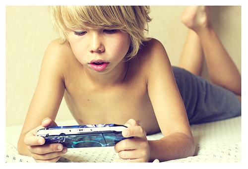 Boy Playing PSP 500x341