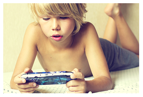 Boy Playing PSP 500x341